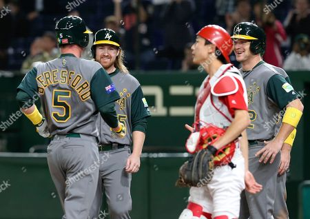 James Beresford, Mitch Nilsson, Brad Harman, Li Nin Australia's James Beresford (5) is welcomed by teammates Mitch Nilsson, second from left, and Brad Harman, right, at home after hitting a grand slam off China's pitcher Lu Chao in the eighth inning of their first round game of the World Baseball Classic at Tokyo Dome in Tokyo, . Second from right is China's catcher Li Nin