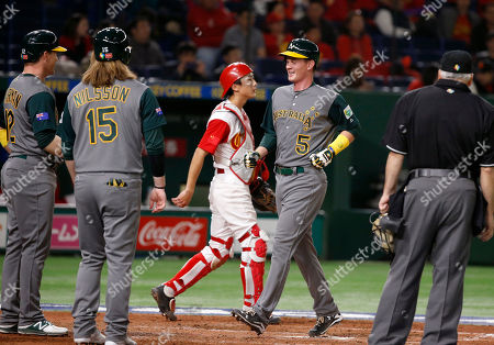 Stock Picture of James Beresford, Brad Harman, Mitch Nilsson, Li Nin Australia's James Beresford (5) is welcomed by teammates Brad Harman, left, and Mitch Nilsson (15) after hitting a grand slam off China's pitcher Lu Chao in the eighth inning of their first round game of the World Baseball Classic at Tokyo Dome in Tokyo, . Center is China's catcher Li Nin