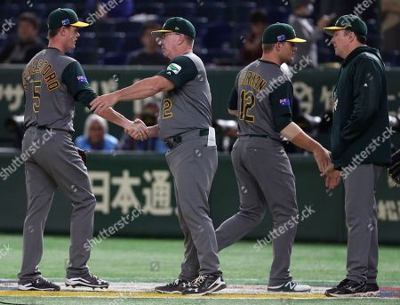 James Beresford, Brad Harman Australia's James Beresford (5) and Brad Harman (12) are congratulated by their coaches after beating China 11-0 in their first round game of the World Baseball Classic at Tokyo Dome in Tokyo