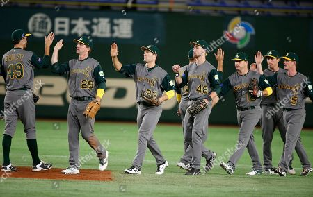 David Kandilas, James Beresford Australia's David Kandilas (29) and James Beresford (5) celebrate with teammates after beating China 11-0 in their first round game of the World Baseball Classic at Tokyo Dome in Tokyo