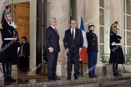 Stock Picture of French President Francois Hollande welcomes his Armenian counterpart Serge Sarkisian