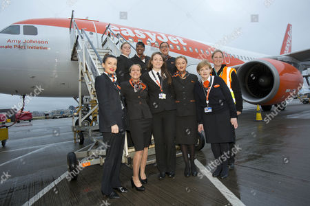 Easyjet celebrates the day with an all-female flight and ground operating crew: Captain Kate McWilliams, 27 - world's youngest female commercial captain, First Officer Sue Barrett, Cabin Manager Laura Marks, cabin crew Natasha Baker, Charlotte Carr and Nuria Belda Marco