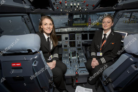 Stock Picture of Easyjet celebrates the day with an all-female flight and ground operating crew: Captain Kate McWilliams, 27 - world's youngest female commercial captain, First Officer Sue Barrett, Cabin Manager Laura Marks, cabin crew Natasha Baker, Charlotte Carr and Nuria Belda Marco