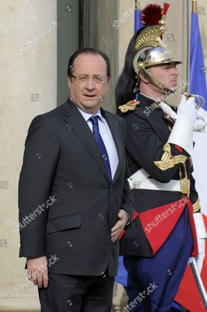 French President Francois Hollande (l) Waits to Greet President of Mali Dioncounda Traore (not Seen) Upon His Arrival at the Elysee Palace in Paris France 17 May 2013 France Paris