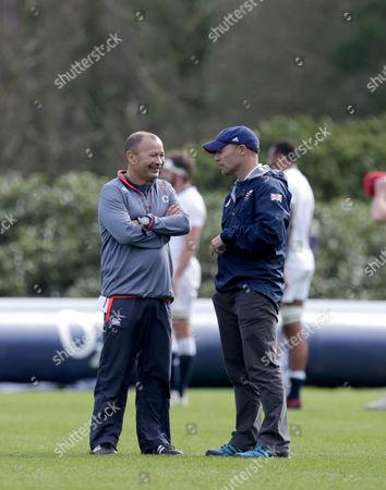 Eddie Jones the England head coach talks with Danny Kerry the GBR Womens Hockey coach