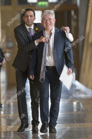 Anas Sarwar (Labour) and Kenneth Gibson (SNP) make their way to the Debating Chamber