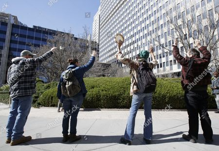 People raise their arms in prayer around the Federal Building where Ravi Ragbir, the executive director of the New Sanctuary Coalition of New York City and a legal immigrant who does not have a normalized status, was attending a check-in meeting with Immigration and Customs Enforcement in New York, New York, USA, 09 March 2017. Ragbir, who legally immigrated to the United States from Trinidad and Tobago more than 25 years ago, a conviction for wire fraud in 2001 put his green card under review and created the threat that he could be deported as a result of this meeting. Following the meeting he was not detained for deportation.