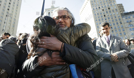 Ravi Ragbir (C), the executive director of the New Sanctuary Coalition of New York City and a legal immigrant who does not have a normalized status, is embraced by a supporter before voluntarily attending a check-in meeting with Immigration and Customs Enforcement in New York, New York, USA, 09 March 2017. Ragbir, who legally immigrated to the United States from Trinidad and Tobago more than 25 years ago, a conviction for wire fraud in 2001 put his green card under review and created the threat that he could be deported as a result of this meeting. Following the meeting he was not detained for deportation.