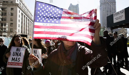 Protester Barbara Stern, of New York, carries a US flag while joining others in walking around the Federal Building where Ravi Ragbir, the executive director of the New Sanctuary Coalition of New York City and a legal immigrant who does not have a normalized status, was attending a check-in meeting with Immigration and Customs Enforcement in New York, New York, USA, 09 March 2017. Ragbir, who legally immigrated to the United States from Trinidad and Tobago more than 25 years ago, a conviction for wire fraud in 2001 put his green card under review and created the threat that he could be deported as a result of this meeting. Following the meeting he was not detained for deportation.