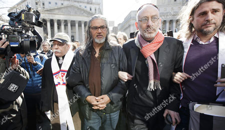 Ravi Ragbir (C), the executive director of the New Sanctuary Coalition of New York City and a legal immigrant who does not have a normalized status, walks arm-in-arm with supporters to voluntarily attend a check-in meeting with Immigration and Customs Enforcement in New York, New York, USA, 09 March 2017. Ragbir, who legally immigrated to the United States from Trinidad and Tobago more than 25 years ago, a conviction for wire fraud in 2001 put his green card under review and created the threat that he could be deported as a result of this meeting. Following the meeting he was not detained for deportation.