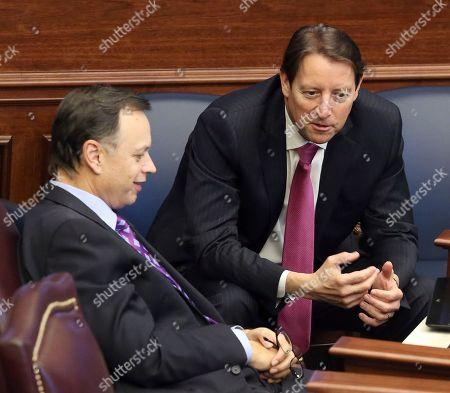 Bill Glavon, Tom Lee Senator Tom Lee, R-Brandon, left, confers with Senator Bill Galvano, R-Bradenton, during session, in Tallahassee, Fla