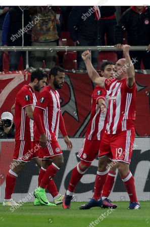 Olympiacos' Esteban Cambiasso (R) reacts after scoring the 1-0 lead during the UEFA Europa League Round of 16 first leg match Olympiacos vs Besiktas in Athens, Greece, 09 March 2017.