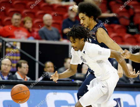 Jalen Moore, Lindsey Drew Utah State's Jalen Moore, right, and Nevada's Lindsey Drew go after a loose ball during the first half of an NCAA college basketball game in the Mountain West Conference tournament, in Las Vegas