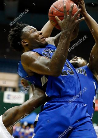 Ashland's Richard Brooks (23) fights for control of a rebound against Shaw during the first half of their boys Class 1A high school basketball championship game, in Jackson, Miss