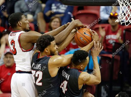 Paul Watson, Tim Williams, Elijah Brown Fresno State's Paul Watson, (3) and New Mexico's Tim Williams (32) and Elijah Brown (4) reach for a rebound during the second half of an NCAA college basketball game in the Mountain West Conference tournament, in Las Vegas. Fresno State won 65-60