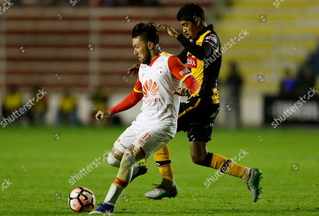 Jonathan Gomez, Raul Castro Jonathan Gomez of Colombia's Independiente Santa Fe, front, fights for the ball with Raul Castro of Bolivia's The Strongest during a Copa Libertadores soccer match in La Paz, Bolivia