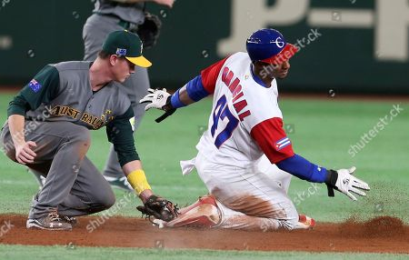 Stock Photo of Yurisbel Gracial, James Beresford Cuba's Yurisbel Gracial steals second as Australia's second baseman James Beresford tries to tag out during the sixth inning of their first round game of the World Baseball Classic at Tokyo Dome in Tokyo