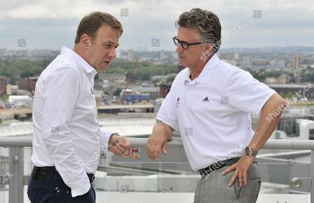 Stock Image of Team Gb Chef De Mission Andy Hunt Talks with Team Gb Athletics Head Coach Charles Van Commenee United Kingdom London