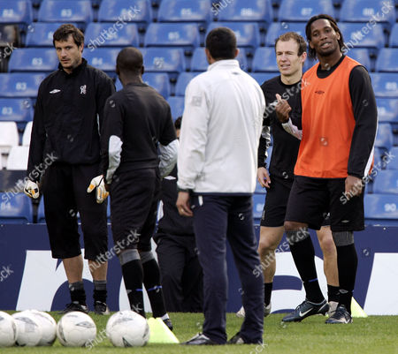 Stock Picture of Chelsea's Didier Drogba shares a joke with assistant coach Baltemar Brito as Arjen Robben and Carlo Cudicini, far left, look on