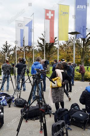 Journalists Stand Outside the Fifa Headquarters in Zuerich Switzerland 08 October 2015 Fifa President Joseph Blatter Vice-president and Uefa President Michel Platini and General Secretary Jerome Valcke Are Provisionally Banned For 90 Days by Fifa Ethics Committee