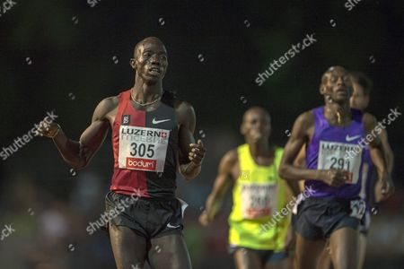 Lomong Lopez (l) From the Usa and Bernard Lagat (r) From the Usa During the Men's 3000m Race at the International Athletics Meeting in Lucerne Switzerland Tuesday July 14 2015