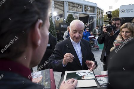 German Actor Musician Painter and Writer Armin Mueller-stahl (c) Signs Autographs to Fans On the Green Carpet Before the Screening of the Movie 'Night On Earth' and a Lifetime Achievement Award Ceremony During the Zurich Film Festival (zff) in Zurich Switzerland 28 September 2015 the Festival Runs From 24 September to 04 October