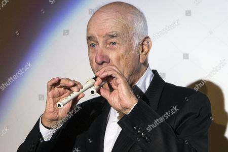 German Actor Musician Painter and Writer Armin Mueller-stahl Plays the Flute On Stage After Receiving the Golden Eye Lifetime Achievement Award During the Zurich Film Festival (zff) in Zurich Switzerland 28 September 2015 the Festival Runs From 24 September to 04 October