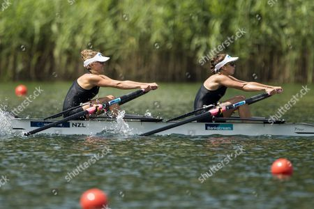 Julia Copeland and Charlotte Taylor (from Right) of New Zealand in Action During the Lightweight Women Double Sculls Semi Final at the Rowing World Cup On Lake Rotsee in Lucerne Switzerland Saturday July 11 2015