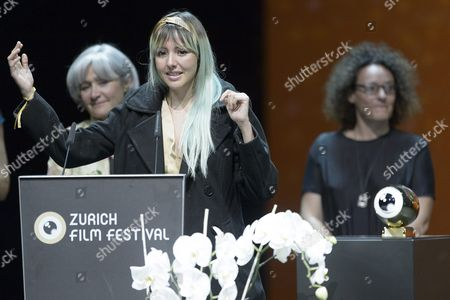 Stock Picture of Betzabe Garcia Winner in the Category International Documentary Film with Her Movie 'Los Reyes Del Pueblo Que No Existe' Receives the Golden Eye and Speaks to the Public During the Award Night at Zurich Film Festival (zff) in Zurich Switzerland 03 October 2015 the Festival Runs From September 24 to 04 October 2015
