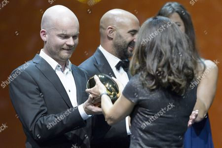 Icelandic Grimur Hakonarson Winner in the Category International Feature Film with His Movie Hrutar (rams) Receives the Golden Eye From Elizabeth Karlsen of the Jury During the Award Night at Zurich Film Festival (zff) in Zurich Switzerland 03 October 2015 the Festival Runs From September 24 to 04 October 2015