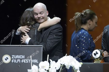 Icelandic Grimur Hakonarson Winner in the Category International Feature Film with His Movie Hrutar (rams) Receives the Golden Eye and Gets a Hug From Elizabeth Karlsen of the Jury During the Award Night at Zurich Film Festival (zff) in Zurich Switzerland 03 October 2015 the Festival Runs From September 24 to 04 October 2015