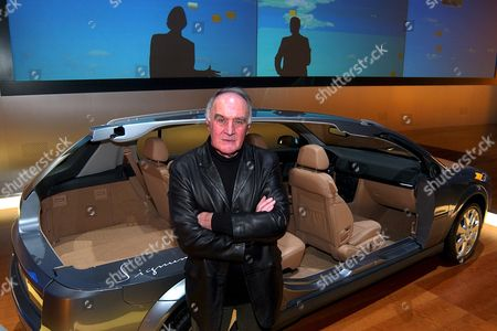 Stock Picture of Ge171 - 20030304 - Geneva Switzerland : French Stuntman Remy Julienne Best Known For His Motor Stunts in the James Bond Movies Poses in Front of the New Opel Signum During the Press Days at the 73rd Geneva International Motor Show Tuesday March 4 2003 in Geneva Switzerland Benefiting From an Additional Show-room This Year's Motor Show Offers an Exhibition Space of 76'000 M2 where Over 900 Brands with Numerous World and European Firsts Will Be Presented to Public From 6 to 16 March Epa Photo Keystone/sandro Campardo/sc Ms Switzerland Schweiz Suisse Geneva