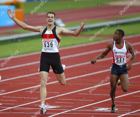 Lem73 - 20020808 Munich Germany: German Ingo Schultz (l) Win's the Men's 400m Final at the European Athletics Championships in Munich 08 August 2002 Spain's David Canal (not Pictured ) Placed Second Britain's Daniel Caines (r) Came in Third Epa Photo Keystone Fabrice Coffrini Germany Munich