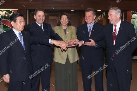 Mos120 - 20010714 - Moscow Russian Federation : International Olympic Comittee Ioc Candidates to Succeed Ioc President Juan Antonio Samaranch From Left to Right : Un Yong Kim of South Korea Jacques Rogge of Belgium Anita Defrantz of Usa Pal Schmitt of Hungary and Dick Pound of Canada Pose For Photographers at the Ioc Session in Moscow Saturday 14 July 2001 the New Ioc President Will Be Elected During the 112th Ioc Session in Moscow On Monday 16 July Epa Photo Keystone/fabrice Coffrini/fc/mda Russian Federation Moscow
