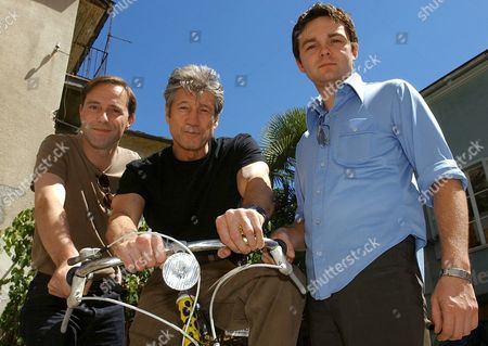 Loc291 Fest - 20020807 - Locarno Switzerland : Swiss Actors Stefan Kurt Left and Fred Koehler Right and Us Actor Fred Ward Center Pose with a Festival Bicycle After the Press Presentation of Their Movie 'Birdseye' at the 55th International Film Festival of Locarno On Wednesday August 7 2002 in Locarno the Film Will Be Shown out of Competiton Epa Photo Keystone/martial Trezzini/mai Switzerland Schweiz Suisse Locarno