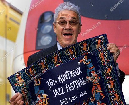 Lau101 Jazz - 20020425 - Lausanne Switzerland : Montreux Jazz Festival Director Claude Nobs Jokes As He Poses with This Year's Poster Prior to His Announcing the Program of the 36th Montreux Jazz Festival in Montreux Switzerland Thursday 25 April 2002 From July 5 to July 20 2002 the Montreux Jazz Festival Will Again Be the Place For Numerous Living Legends and Talents with Names Like David Bowie Isaac Hayes Paul Simon Jamiroquai Daniela Mercury Ub 40 P Diddy Joe Cocker and Garbage Regular Guests Like B B King Keith Jarrett Or Herbie Hancock Complete the Top-class Programme Epa Photo Keystone Fabrice Coffrini Switzerland Schweiz Suisse Lausanne