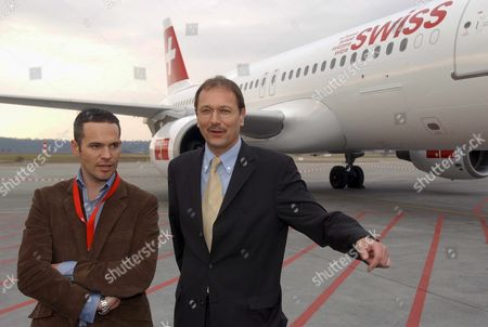 Bas122 - 20020131 - Lausanne Switzerland : Andre Dose (r) Ceo of the New Swiss Air Lines and Canadian Designer Tyler Brule Pose in Front of the First Airplane an Airbus Painted with the New Brand Name 'Swiss' the Merged Result of the Former Swiss Airlines Swissair and Crossair Thursday 31 January 2002 in Basel While Dose Heads the New Carrier Brule is Responsible For the Name and Design of Its Brand Epa Photo Keystone/markus Stuecklin Switzerland Schweiz Suisse Lausanne