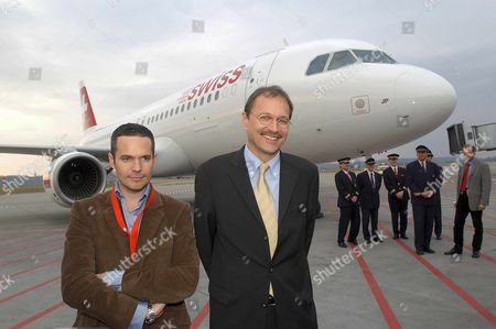Bas124 - 20020131 - Lausanne Switzerland : Andre Dose (c) Ceo of the New Swiss Air Lines and Canadian Designer Tyler Brule (l) Pose in Front of the First Airplane an Airbus Painted with the New Brand Name 'Swiss' the Merged Result of the Former Swiss Airlines Swissair and Crossair Thursday 31 January 2002 in Basel While Dose Heads the New Carrier Brule is Responsible For the Name and Design of Its Brand Epa Photo Keystone/markus Stuecklin Switzerland Schweiz Suisse Lausanne