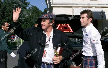 Lau105 - 19990724 - Lausanne Switzerland : Former Motor Racing Champion Jacky Stewart (l) Waves to the Crowd As He Arrives with His Son Paul at a Hotel in Lausanne Saturday 24 July For the Wedding Cerenomy of British Pop Singer Phil Collins Phil Collins Married Swiss Orianne Cevey (electronic Image) Epa Photo Keystone/fabrice Coffrini Switzerland Schweiz Suisse Lausanne