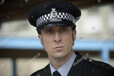 Andrew Brooke as Sergeant Harris.