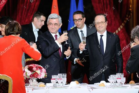 French President Francois Hollande and Armenian President Serzh Sargsyan toast together during an official dinner at the Elysee Palace