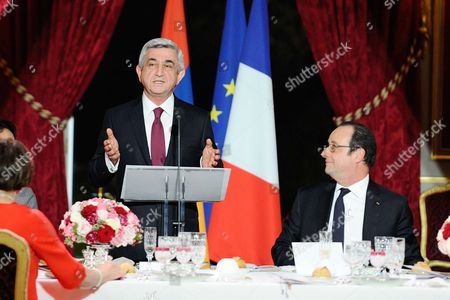 Armenian President Serzh Sargsyan delivers a speech in presence of French President Francois Hollande during an official dinner at the Elysee Palace