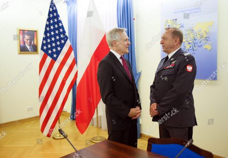 Stock Image of Us Secretary of the Navy Ray Mabus (l) Talks with Polish General Commander of the Armed Forces Types Gen Lech Majewski (r) During a Meeting with Polish Defence Minister Tomasz Siemoniak (not Seen) in Warsaw Poland 15 June 2015 the Meeting is on Polish-us Military Cooperation and Polish-us Joint Naval Exercises Poland Warsaw