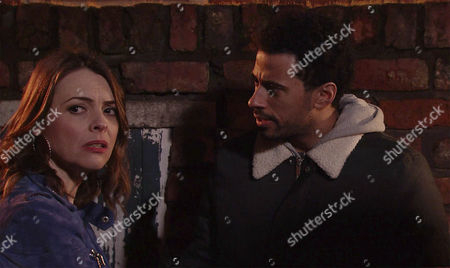 Luke Britton, as played by Dean Fagan, and Tracy Barlow, as played by Kate Ford, search for Amy in the ginnel, unaware of a figure watching them from the shadows. (Ep 9130 - Mon 27 Mar 2017)