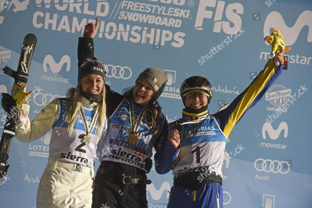 Stock Picture of (L-R) Australian Danielle Scott, silver medal, US Ashley Caldwell, gold medal, and Chinese Mengtao Xu, brozne medal, celebrate on the podium after the Women's Final Aerials of the FIS Freestyle Ski and Snowboard World Championships 2017 in the Sierra Nevada, near Granada, southern Spain, 10 March 2017.