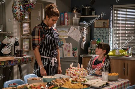 When April Windsor, as played by Amelia Flanagan, chokes violently on a sweet, Marlon Dingle, as played by Mark Charnock, is shocked to realise Carly Hope, as played by Gemma Atkinson, does nothing to help her. (Ep 7771 - Mon 13 Mar 2017)