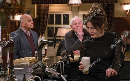 Faith Dingle, as played by Sally Dexter, strings along Rishi Sharma, as played by Bhasker Patel, and Pollard, as played by Christopher Chittell. (Ep 7775 - Thur 16 Mar 2017)