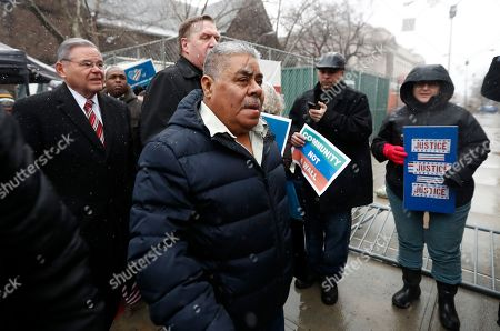Catalino Guerrero, center, walks with U.S. Senator Bob Menendez, left, and Newark Archbishop Cardinal Joseph Tobin, center left, during a rally outside of the Newark immigration building before attending an immigration hearing, in Newark, N.J. Guerrero, who arrived in the U.S. illegally in 1991, is facing deportation. Organizers claim he is an upstanding citizen and should not be deported