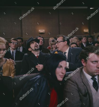 Eric Morecambe (as Eric Morecambe) and Tutte Lemkow (as Seedy Schlecht Agent)