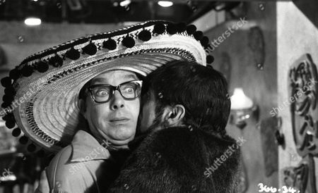 Eric Morecambe (as Eric Morecambe) with Tutte Lemkow (as Seedy Schlecht Agent)